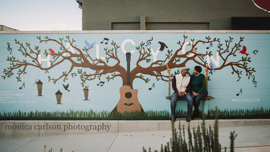 couple siting on a painted swing art during a family photo session