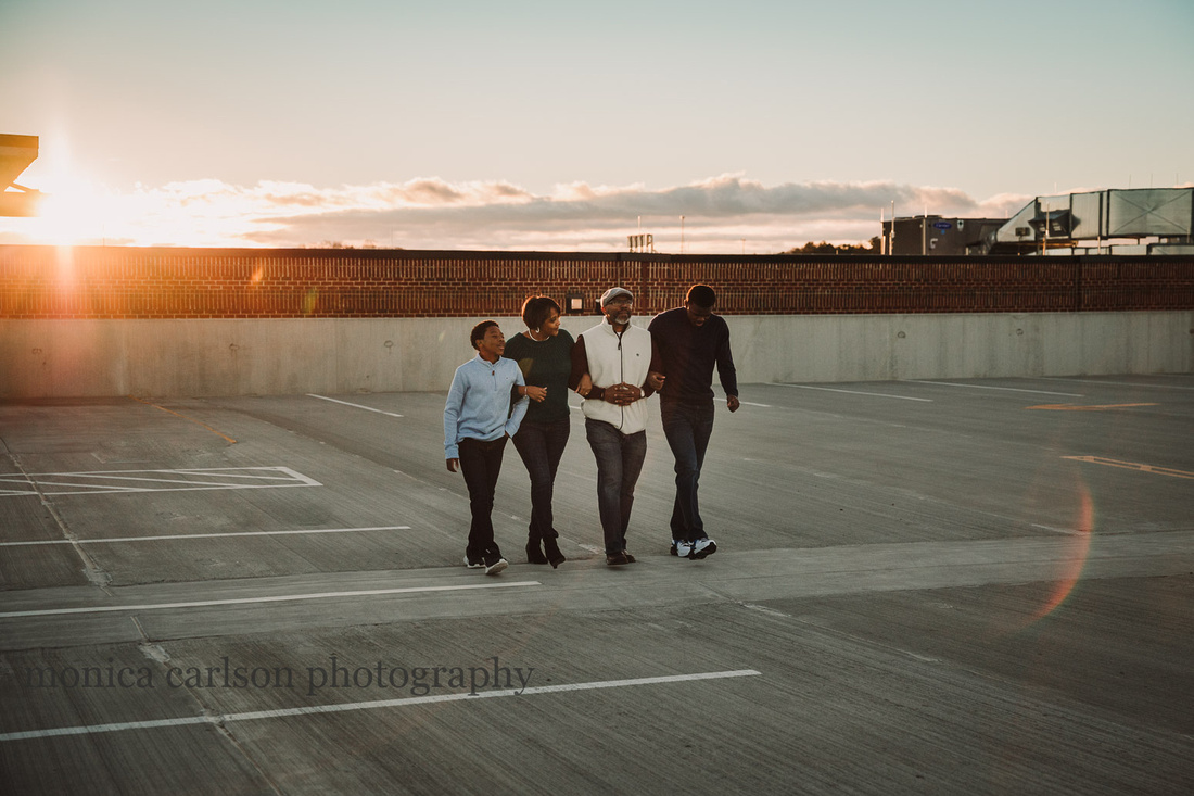 family of four walks together on the roof of a parking lot at Halcyon forsyth
