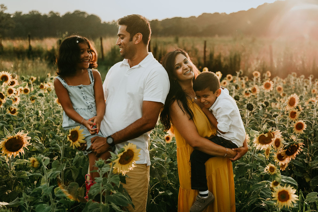family of four happily love on each other during a photo session by monica carlson photography
