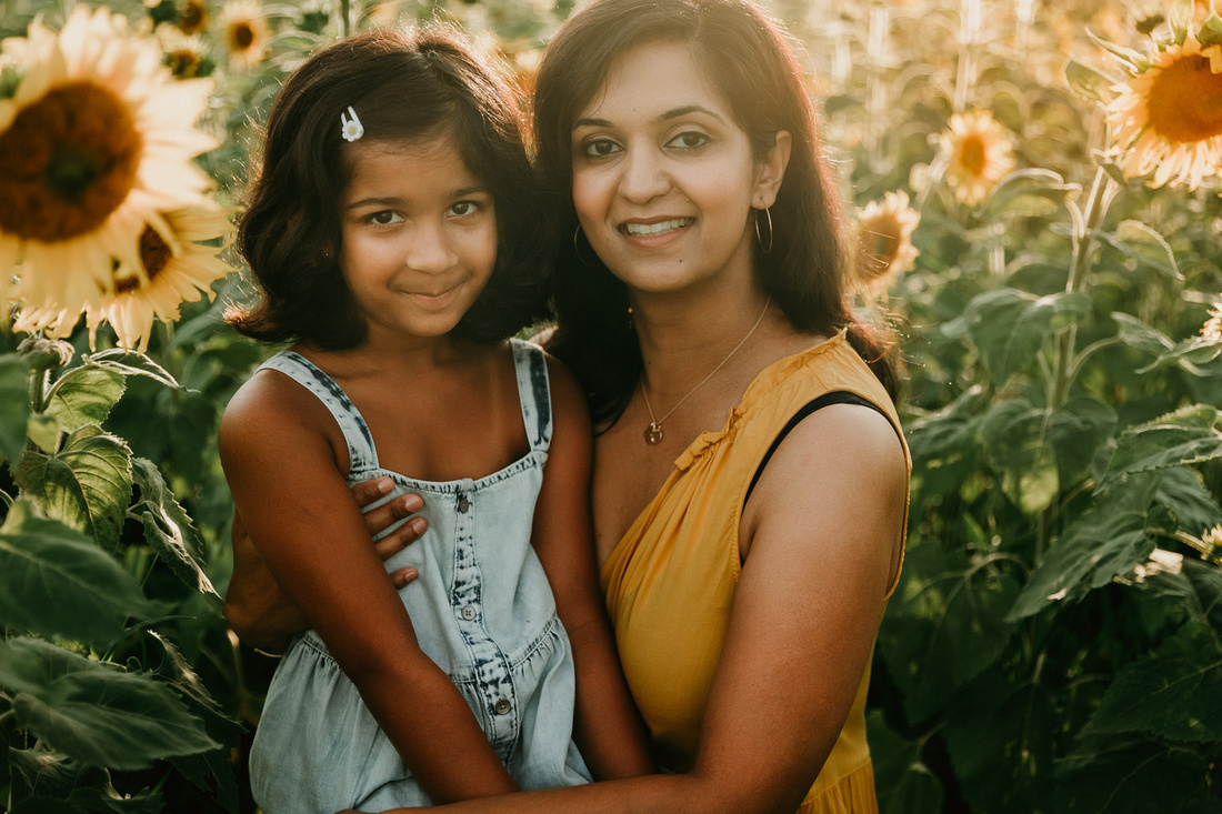 indian mother and elementary age daughter smile for the camera during a photo session at Prospect farms