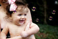 7 monith old baby in a bath by monica carlson photography